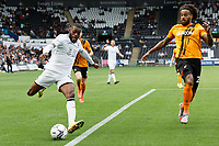 Olivier Ntcham of Swansea City (L) takes a cross during the Sky Bet Championship match between Swansea City and Hull City at the Swansea.com Stadium, Swansea, Wales, UK. Saturday 11 September 2021