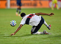 LAKE BUENA VISTA, FL - JULY 26: Derek Cornelius of Vancouver Whitecaps FC tries to regain his balance to control the ball during a game between Vancouver Whitecaps and Sporting Kansas City at ESPN Wide World of Sports on July 26, 2020 in Lake Buena Vista, Florida.
