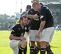 Dundee's Craig Beattie is congratulated by Dundee's Iain Davidson after scoring their third goal.