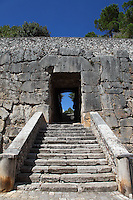 Alatri: The main entrance, across the fortifications known as Mura Ciclopiche (XI century),  to the citadel in the center of Alatri, Porta Maggiore, with its extremely large architrave. The blue sky, the green trees and the staircase enhance the opening to be crossed.