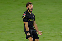 22nd December 2020, Orlando, Florida, USA;  LAFC Diego Rossi celebrates after scoring a goal during the Concacaf Championship between LAFC and Tigres UANL on December 22, 2020, at Exploria Stadium in Orlando, FL.