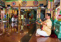 Musician Playing a Nadaswaram, an Indian Wind Instrument, Sri Mahamariamman Hindu Temple, Kuala Lumpur, Malaysia.