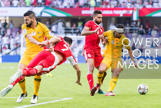Massimo Luongo of Australia (R) fights for the ball with Saeed Almurjan of Jordan (2nd R) as Yousef Rawshdeh of Jordan (2nd L) jumps past Aziz Behich of Australia (L) during the AFC Asian Cup UAE 2019 Group B match between Australia (AUS) and Jordan (JOR) at Hazza Bin Zayed Stadium on 06 January 2019 in Al Ain, United Arab Emirates. Photo by Marcio Rodrigo Machado / Power Sport Images