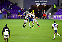ORLANDO CITY, FL - JANUARY 31: Miles Robinson #12 of the United States battles with Ryan Telfer #7 of Trinidad and Tobago during a game between Trinidad and Tobago and USMNT at Exploria stadium on January 31, 2021 in Orlando City, Florida.