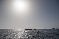 """Sea Watch-2.<br /> Die Sea Watch-2 bei ihrer 13. SAR-Mission vor der libyschen Kueste.<br /> Im Bild: Ein ueberfuelltes Schlauchboot mit ca. 150 Gefluechteten. Sie trieben ueber Stunden orientierungslos herum, denn der Motor wurde ihnen von sog Engine-Fischern abgenommen. Sie haben Schwimmwesten von der Sea Watch-2 und der Dignity-1 der Organisation """"Aertze ohne Grenzen"""" bekommen. Die italienische Kuestenwache ist gekommen (rechts) um Menschen nach Italien zu bringen.<br /> 22.10.2016, Mediterranean Sea<br /> Copyright: Christian-Ditsch.de<br /> [Inhaltsveraendernde Manipulation des Fotos nur nach ausdruecklicher Genehmigung des Fotografen. Vereinbarungen ueber Abtretung von Persoenlichkeitsrechten/Model Release der abgebildeten Person/Personen liegen nicht vor. NO MODEL RELEASE! Nur fuer Redaktionelle Zwecke. Don't publish without copyright Christian-Ditsch.de, Veroeffentlichung nur mit Fotografennennung, sowie gegen Honorar, MwSt. und Beleg. Konto: I N G - D i B a, IBAN DE58500105175400192269, BIC INGDDEFFXXX, Kontakt: post@christian-ditsch.de<br /> Bei der Bearbeitung der Dateiinformationen darf die Urheberkennzeichnung in den EXIF- und  IPTC-Daten nicht entfernt werden, diese sind in digitalen Medien nach §95c UrhG rechtlich geschuetzt. Der Urhebervermerk wird gemaess §13 UrhG verlangt.]"""