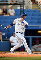 Toronto Blue Jays outfielder Michael Saunders (8) grounds out in the first inning while on rehab assignment with the Dunedin Blue Jays during a game against the Clearwater Threshers on April 10, 2015 at Florida Auto Exchange Stadium in Dunedin, Florida.  Clearwater defeated Dunedin 2-0.  (Mike Janes/Four Seam Images)