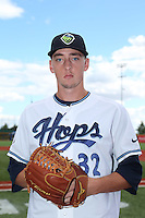 Taylor Clarke (32) of the Hillsboro Hops poses for a photo before a game against the Salem-Keizer Volcanoes at Ron Tonkin Field on July 26, 2015 in Hillsboro, Oregon. Hillsboro defeated Salem-Keizer, 4-3. (Larry Goren/Four Seam Images)