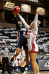 SIOUX FALLS, SD - MARCH 6: Tierney Coleman #2 of the Oral Roberts Golden Eagles shoots past the defense of Natalie Mazurek #23 of the South Dakota Coyotes during the Summit League Basketball Tournament at the Sanford Pentagon in Sioux Falls, SD. (Photo by Dave Eggen/Inertia)