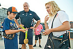 ABERDEEN, MD - SEPTEMBER 01: Braydon McCormick, 10 of Baltimore and a leukemia survivor, gets a chance to hold the gold medal of Olympic wrestler Helen Maroulis, as Cal Ripken, Jr. looks on before the Aberdeen Ironbirds game and Ironbirds Stadium on September 1, 2016 in Aberdeen, Maryland. (Photo by Scott Serio/Eclipse Sportswire/Getty Images)