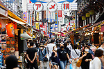 People wearing protective masks walk in Tokyo's Ueno shopping district, Japan on May 26, 2020, on the first day after the Japanese government lifted a coronavirus state of emergency. (Photo by Naoki Morita/AFLO)