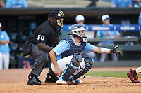 North Carolina Tar Heels catcher Cody Roberts (11) sets a target as home plate umpire Troy Fullwood looks on during the game against the Florida State Seminoles in the 2017 ACC Baseball Championship Game at Louisville Slugger Field on May 28, 2017 in Louisville, Kentucky. The Seminoles defeated the Tar Heels 7-3. (Brian Westerholt/Four Seam Images)