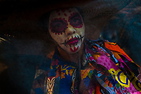 A Mexican woman, dressed as La Catrina, a Mexican pop culture icon representing the Death, takes part in the Day of the Dead celebrations in Oaxaca, Mexico, 30 October 2019. Day of the Dead (Día de Muertos), a religious holiday combining the death veneration rituals of Pre-Hispanic cultures with the Catholic practice, is widely celebrated throughout all of Mexico. Based on the belief that the souls of the departed may come back to this world on that day, people gather together while either praying or joyfully eating, drinking, and playing music, to remember friends or family members who have died and to support their souls on the spiritual journey.