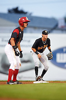 West Virginia Black Bears second baseman Tyler Leffler (30) holds base runner Corey Bird (12) on during a game against the Batavia Muckdogs on August 20, 2016 at Dwyer Stadium in Batavia, New York.  Batavia defeated West Virginia 7-2.  (Mike Janes/Four Seam Images)