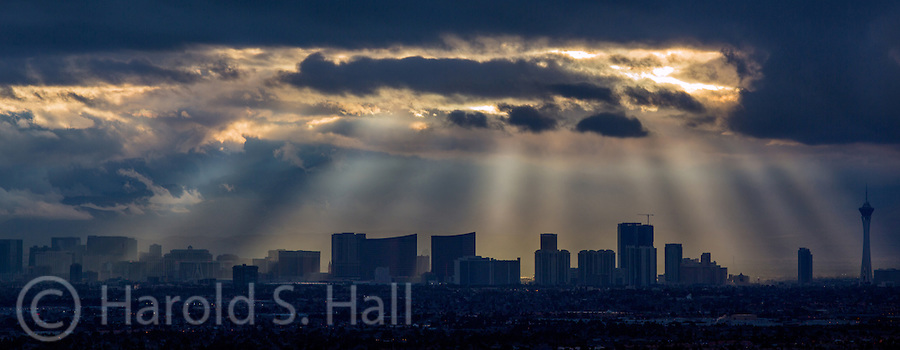 Sin City is bathed in God's Rays as the sun peaks out behind the clouds.