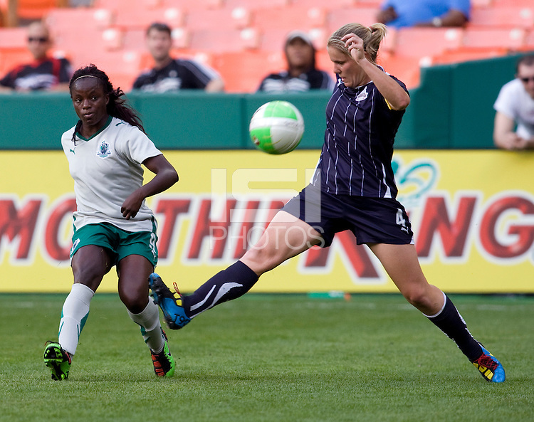 Cat Whitehill (4) of the Washington Freedom tries to defend the cross of Eniola Aluko (9) of the Saint Louis Athletica at RFK Stadium in Washington, DC.  The Washington Freedom defeated Saint Louis Athletica, 3-1.