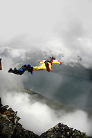 Jo Henrik Endrerud and Jennifer Dembinski exits the mountain. World BASE Race held in Innfjorden, Norway, where BASE jumpers in wingsuits compete in flying down the mountain. The winner is called the World's Fastest Flying Human Being..©Fredrik Naumann/Felix Features.