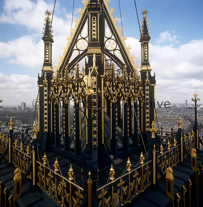 The impressive gold and black flagpole base atop Victoria Tower is decorated with gothic finials, gilt leaves and lions' heads