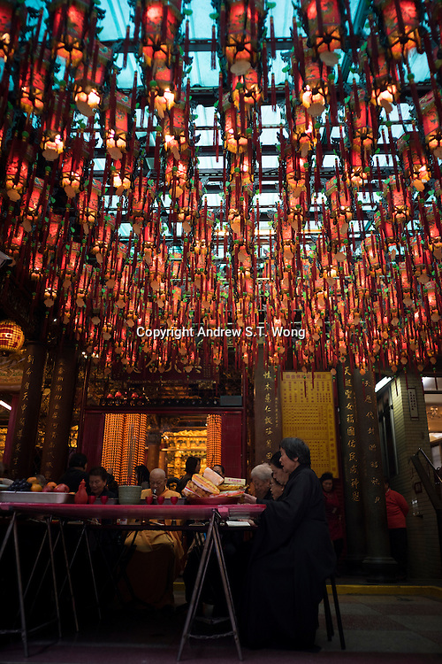 Believers offer prayers at Tianhou Temple in Ximending District of Taipei, Taiwan, 2015.