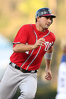 Washington Nationals third baseman Ryan Zimmerman #11 runs the bases against the Los Angeles Dodgers at Dodger Stadium on July 23, 2011 in Los Angeles,California. Los Angeles defeated Washington 7-6.(Larry Goren/Four Seam Images)