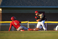 Batavia Muckdogs first baseman Eric Gutierrez (43) looks to tag Jesus Alastre (5) sliding back to first base during a game against the Williamsport Crosscutters on September 3, 2016 at Dwyer Stadium in Batavia, New York.  Williamsport defeated Batavia 10-0. (Mike Janes/Four Seam Images)