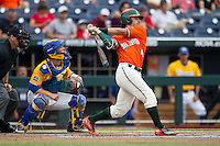 Miami Hurricanes second baseman Johnny Ruiz (4) follows through on his swing against the UC Santa Barbara Gauchos in Game 5 of the NCAA College World Series on June 20, 2016 at TD Ameritrade Park in Omaha, Nebraska. UC Santa Barbara defeated Miami  5-3. (Andrew Woolley/Four Seam Images)