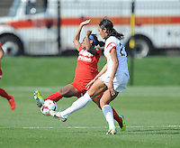 Boyds MD - April 13, 2014: Crystal Dunn (19) of the Washington Spirit goes against Haley Palmer (23) of the Western New York Flash. The Western New York Flash defeated the Washington Spirit 3-1 in the opening game of the 2014 season of the National Women's Soccer League at the Maryland SoccerPlex.