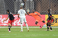 WASHINGTON, DC - AUGUST 25: Teal Bunbury #10 of New England Revolution attempts a shot on goal against Bill Hamid #24 of D.C. United during a game between New England Revolution and D.C. United at Audi Field on August 25, 2020 in Washington, DC.