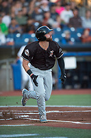 Salem-Keizer Volcanoes right fielder Dalton Combs (31) runs down the first base line during a Northwest League game against the Hillsboro Hops at Ron Tonkin Field on September 1, 2018 in Hillsboro, Oregon. The Salem-Keizer Volcanoes defeated the Hillsboro Hops by a score of 3-1. (Zachary Lucy/Four Seam Images)