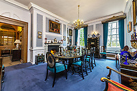 BNPS.co.uk (01202 558833)<br /> Pic: KnightFrank/BNPS<br /> <br /> Pictured: A dining room.<br /> <br /> A spectacular Georgian mansion that was home to an eccentric and legendary poet during the war is on the market for £10.5m.<br /> <br /> Grade II* Listed South End House was home to Walter de la Mare in the 1940s and the writer was reprimanded for failing to observe the blackout during the Second World War.<br /> <br /> The impressive property is in a prime location on an exclusive cul-de-sac with incredible park views and glimpses of the Thames.<br /> <br /> On one occasion during the war, police rowed across the river to complain his upper windows were beaconing to the far bank.