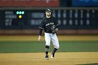 Wake Forest Demon Deacons third baseman Jake Mueller (23) on defense against the Illinois Fighting Illini at David F. Couch Ballpark on February 16, 2019 in  Winston-Salem, North Carolina.  The Fighting Illini defeated the Demon Deacons 5-2. (Brian Westerholt/Four Seam Images)