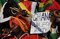 A Ghana fan remembers the earthquake vitims of Haiti prior to his tem's match. Ghana defeated Serbia, 1-0, June 13th, in the opening match of Group D of the 2010 FIFA World Cup.