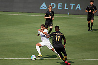 LOS ANGELES, CA - AUGUST 22: Jonathan dos Santos #8 of the Los Angeles Galaxy moves with the ball during a game between Los Angeles Galaxy and Los Angeles FC at Banc of California Stadium on August 22, 2020 in Los Angeles, California.