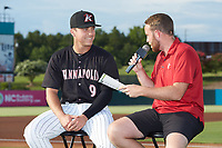 Kannapolis Intimidators media relations director Trevor Wilt (right) interviews pitcher Jacob Lindgren (9) prior to the game against the Lakewood BlueClaws at Kannapolis Intimidators Stadium on July 18, 2019 in Kannapolis, North Carolina. The Intimidators defeated the BlueClaws 7-1. (Brian Westerholt/Four Seam Images)