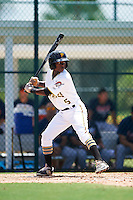 GCL Pirates shortstop Victor Ngoepe (5) at bat during a game against the GCL Braves on August 10, 2016 at Pirate City in Bradenton, Florida.  GCL Braves defeated the GCL Pirates 5-1.  (Mike Janes/Four Seam Images)