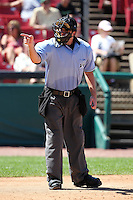 Umpire John Bacon during a game at Elfstrom Stadium in Geneva, Illinois;  August 15, 2010.  Photo By Mike Janes/Four Seam Images