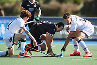 Nic Woods of North is tackled by Jacob Smith of South during the Men's North v South hockey match, St Pauls Collegiate, Hamilton, New Zealand. Saturday 17 April 2021 Photo: Simon Watts/www.bwmedia.co.nz