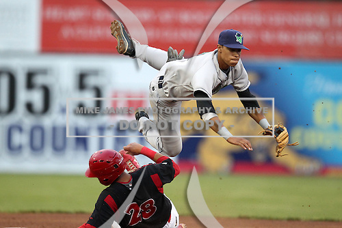 Jamestown Jammers shorstop Noah Perio attempts a double play over Jon Rodriguez during a game vs. the Batavia Muckdogs at Dwyer Stadium in Batavia, New York July 31, 2010.   Batavia defeated Jamestown 6-1.  Photo By Mike Janes/Four Seam Images