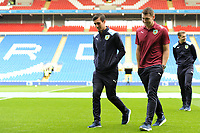 Jack Cork (left) and Sam Vokes (right) of Burnley walk the pitch prior to the Premier League match between Cardiff City and Burnley at Cardiff City Stadium in Cardiff, Wales, UK. Sunday 30 September 2018