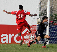 Fernando Pina (1) of the United States makes a save on the shot of Alfredo Stephens (19) of Panama during the group stage of the CONCACAF Men's Under 17 Championship at Jarrett Park in Montego Bay, Jamaica. The USA defeated Panama, 1-0.