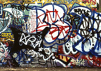 Wall covered with graffiti, urban blight and decay; art.