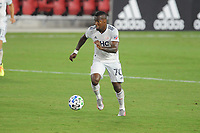 WASHINGTON, DC - AUGUST 25: Teal Bunbury #10 of New England Revolution moves the ball during a game between New England Revolution and D.C. United at Audi Field on August 25, 2020 in Washington, DC.