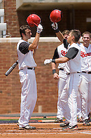 Joe Panik #2 (right) of the St. John's Red Storm taps helmets with teammate Jeremy Baltz #18 after hitting a solo home run against the VCU Rams at the Charlottesville Regional of the 2010 College World Series at Davenport Field on June 5, 2010, in Charlottesville, Virginia.  The Red Storm defeated the Rams 8-6.  Photo by Brian Westerholt / Four Seam Images