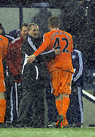 Pictured L-R: Brendan Rodgers manager for Swansea with Gylfi Sigurdsson of Swansea after the end of the game. Saturday, 04 February 2012<br /> Re: Premier League football, West Bromwich Albion v Swansea City FC v at the Hawthorns Stadium, Birmingham, West Midlands.
