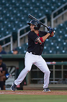 AZL Indians 1 third baseman Daniel Schneemann (15) at bat during an Arizona League game against the AZL White Sox at Goodyear Ballpark on June 20, 2018 in Goodyear, Arizona. AZL Indians 1 defeated AZL White Sox 8-7. (Zachary Lucy/Four Seam Images)