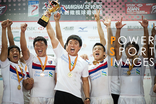 Korea players celebrate on podium after winning the final match against Hong Kong on the Day 2 of the Shanghai 7s, part of the HSBC Asian Sevens Series, at the Yuanshen Stadium on August 28, 2011 in Shanghai, China. Photo by © Victor Fraile / The Power of Sport Images for Fast Track / HSBC
