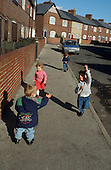 Children play in a street in the ex-pit village of Grimethorpe, South Yorkshire, which lost its major source of employment when the colliery closed in 1993.