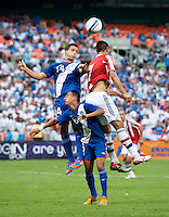 Oscar Cardozo (7) of Paraguay goes up for a header with Luis Rodriguez (14) and Wilfred Velasquez (6) of Guatemala during the game at RFK Stadium in Washington, DC.  Guatemala tied Paraguay, 3-3.