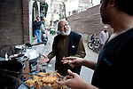 June 21 2012, New Delhi, India:  Pushpesh Pant, Indian academic and author of a definitive book on Indian cuisine ' India Cookbook '.   Here he is seen wandering the streets of Delhi's Sufi Muslim quarter, Nizamuddin, sampling some of the traditional fare on offer such as biryani, kebabs and many types of different breads that are a staple of Indian food        Picture by Graham Crouch/Holland Herald