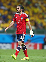 Mario Yepes of Colombia sporting a cast on his left hand/arm