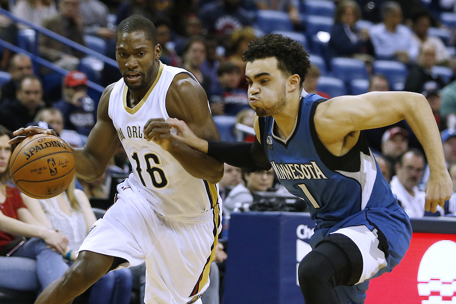 New Orleans Pelicans guard Toney Douglas (16) drives against Minnesota Timberwolves guard Tyus Jones (1) during the first half of an NBA basketball game Saturday, Feb. 27, 2016, in New Orleans. (AP Photo/Jonathan Bachman)